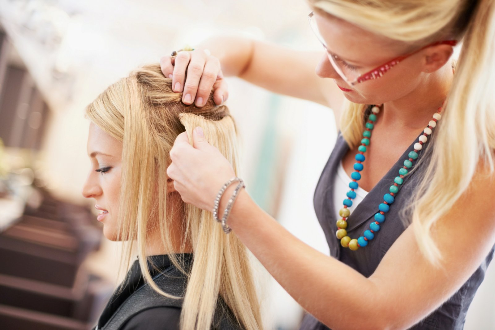 Amaci Salon, best of Boston's beauty salons, stylist adding extensions to a customer's hair